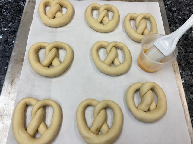 Egg washing pretzels