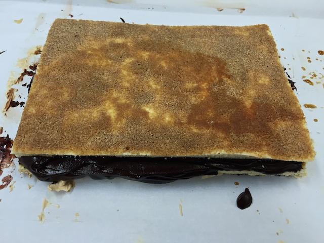 Chocolate ganache plus joconde sponge/coffee syrup layer