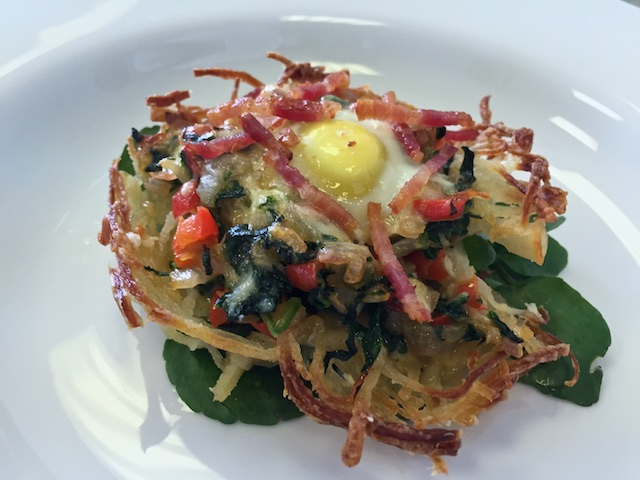 Hashbrowns with red pepper, spinach & bacon bits topped with a quail egg