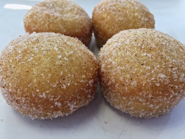 Fried buttermilk biscuit dough, rolled in cinnamon & sugar