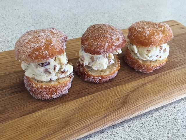 Butter Pecan Ice Cream sandwiched between Fried Buttermilk Biscuits rolled in Cinnamon & Sugar